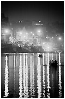Lights reflected in the Ganga River at night. Varanasi, Uttar Pradesh, India (black and white)
