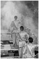 Brahmans standing amongst clouds of incense during puja. Varanasi, Uttar Pradesh, India (black and white)