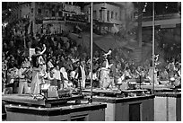 Brahmans performing evening arti ceremony. Varanasi, Uttar Pradesh, India (black and white)