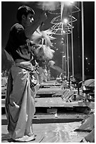 Young Brahman performing arti ceremony. Varanasi, Uttar Pradesh, India (black and white)