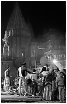 Brahmans giving blessings after evening arti ceremony. Varanasi, Uttar Pradesh, India (black and white)