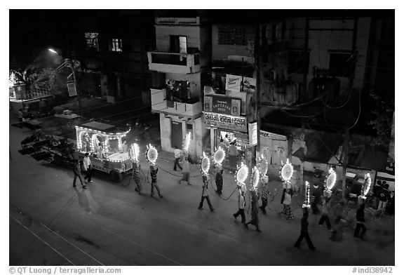 Street wedding procession bright lights seen from above. Varanasi, Uttar Pradesh, India