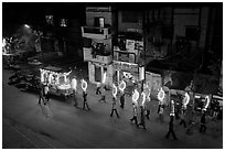 Street wedding procession bright lights seen from above. Varanasi, Uttar Pradesh, India (black and white)