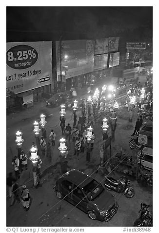 Street and wedding procession by night from above. Varanasi, Uttar Pradesh, India (black and white)