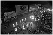 Wedding procession seen from above at night. Varanasi, Uttar Pradesh, India (black and white)