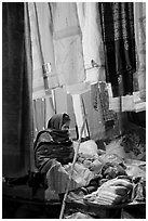 Woman selling fabrics at night. Varanasi, Uttar Pradesh, India (black and white)