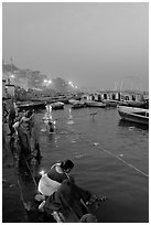 Women soaking clothes in the Ganges River at dawn. Varanasi, Uttar Pradesh, India ( black and white)