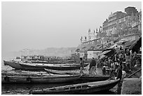 Boats and ghat at sunrise. Varanasi, Uttar Pradesh, India (black and white)