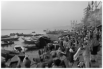 Steps of Dasaswamedh Ghat with crowd at sunrise. Varanasi, Uttar Pradesh, India (black and white)
