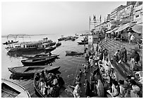 Activity on the steps of Dasaswamedh Ghat, early morning. Varanasi, Uttar Pradesh, India (black and white)