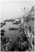 Boat unloading pilgrim onto Dasaswamedh Ghat, early morning. Varanasi, Uttar Pradesh, India (black and white)