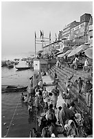 People about to bathe in the Ganga River at sunrise. Varanasi, Uttar Pradesh, India (black and white)