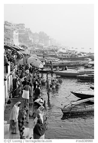 People and boats on the banks of the Ganges River, Dasaswamedh Ghat. Varanasi, Uttar Pradesh, India (black and white)