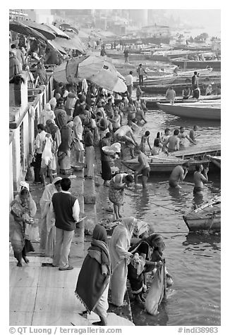 Gathering on the banks of Ganges River, sunrise. Varanasi, Uttar Pradesh, India (black and white)