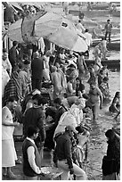 Colorful crowd at the edge of water, Dasaswamedh Ghat. Varanasi, Uttar Pradesh, India (black and white)