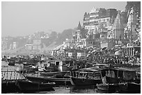 Boats and temples of Dasaswamedh Ghat, sunrise. Varanasi, Uttar Pradesh, India (black and white)