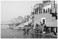 Men dipping in Ganga River at Meer Ghat. Varanasi, Uttar Pradesh, India (black and white)
