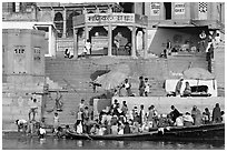 Boats loaded with pilgrims and steps, Manikarnika Ghat. Varanasi, Uttar Pradesh, India (black and white)