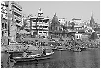 Rowboat and Manikarnika Ghat. Varanasi, Uttar Pradesh, India (black and white)