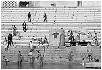 Men finishing their bath below the steps of Scindhia Ghat. Varanasi, Uttar Pradesh, India (black and white)