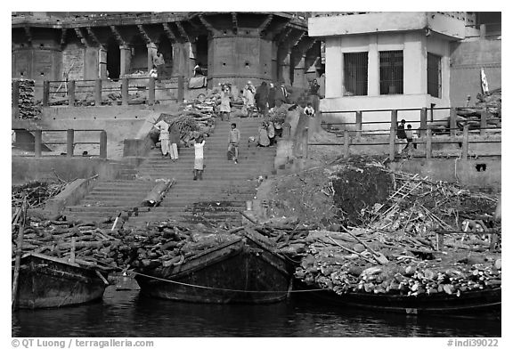 Steps of Manikarnika Ghat with body swathed in cloth and firewood piles. Varanasi, Uttar Pradesh, India (black and white)