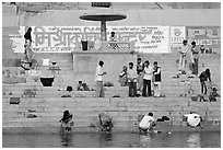 People washing cloths, steps, and Indi inscriptions. Varanasi, Uttar Pradesh, India ( black and white)