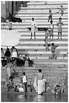 Drying out on stone steps of Meer Ghat. Varanasi, Uttar Pradesh, India (black and white)