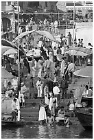 Colorful crowd on steps of Dasaswamedh Ghat. Varanasi, Uttar Pradesh, India (black and white)