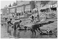 Men washing laundry on Ganga riverbanks. Varanasi, Uttar Pradesh, India (black and white)
