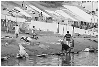 Washing and drying laundry on Ganga riverbank. Varanasi, Uttar Pradesh, India ( black and white)