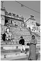 Woman and boy on temple steps, Kedar Ghat. Varanasi, Uttar Pradesh, India (black and white)