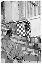 Woman sitting on temple steps. Varanasi, Uttar Pradesh, India (black and white)