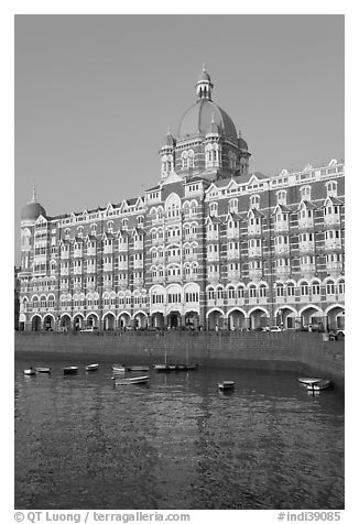 Taj Mahal Palace Hotel and small boats in harbor. Mumbai, Maharashtra, India (black and white)