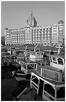 Tour boats in front of Taj Mahal Palace Hotel. Mumbai, Maharashtra, India (black and white)
