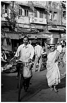 Man riding bike and woman with basket on head, Colaba Market. Mumbai, Maharashtra, India ( black and white)