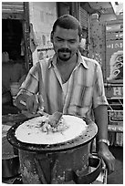 Man preparing breakfast dosa, Colaba Market. Mumbai, Maharashtra, India ( black and white)
