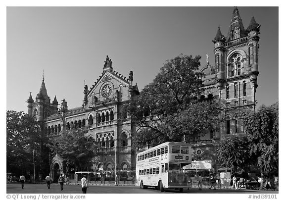 Yellow double-decker bus in front of Victoria Terminus. Mumbai, Maharashtra, India (black and white)