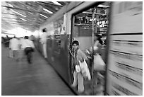 View of departing train with motion blur. Mumbai, Maharashtra, India (black and white)