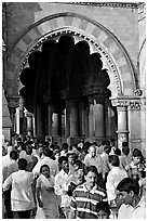 Crowd pass beneath an archway, Chhatrapati Shivaji Terminus. Mumbai, Maharashtra, India ( black and white)