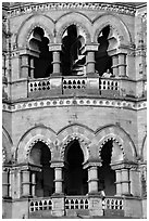 Facade with woman at window, Chhatrapati Shivaji Terminus. Mumbai, Maharashtra, India ( black and white)