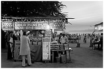 Food kiosks at sunset, Chowpatty Beach. Mumbai, Maharashtra, India (black and white)