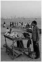 Food vendor on beach at dusk, Chowpatty Beach. Mumbai, Maharashtra, India ( black and white)