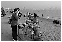 Food stall selling braised corn at twilight,  Chowpatty Beach. Mumbai, Maharashtra, India (black and white)