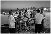 Stall broiling corn at night, Chowpatty Beach. Mumbai, Maharashtra, India ( black and white)