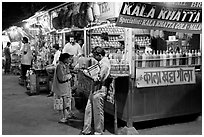 Drinks stall at night, Chowpatty Beach. Mumbai, Maharashtra, India ( black and white)