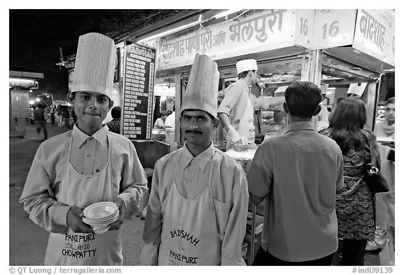 Cooks in front of Panipuri stall, Chowpatty Beach. Mumbai, Maharashtra, India (black and white)