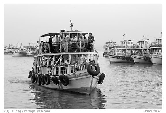 Tour boat loaded with passengers. Mumbai, Maharashtra, India (black and white)