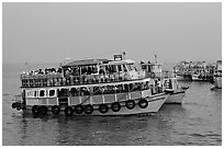 Tour boat at twilight. Mumbai, Maharashtra, India ( black and white)