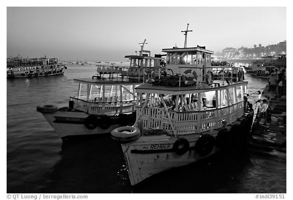 Lighted tour boat at quay,  sunset. Mumbai, Maharashtra, India