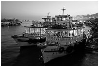 Lighted tour boat at quay,  sunset. Mumbai, Maharashtra, India (black and white)